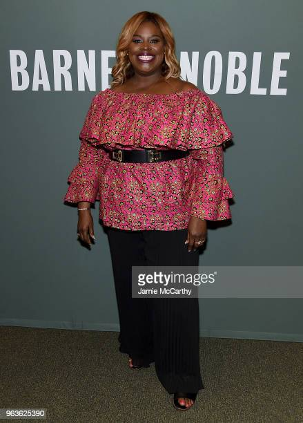"""Retta signs copies of her new book """"So Close To Being The Sh*T Y'all Don't Even Know"""" at Barnes & Noble Tribeca on May 29, 2018 in New York City."""