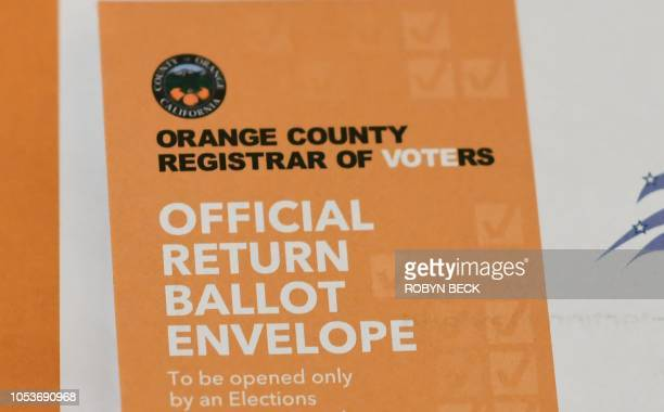Return envelope for a mail-n ballot is seen at a ballot party in a private residence in Laguna Niguel in Orange County California, October 24, 2018....