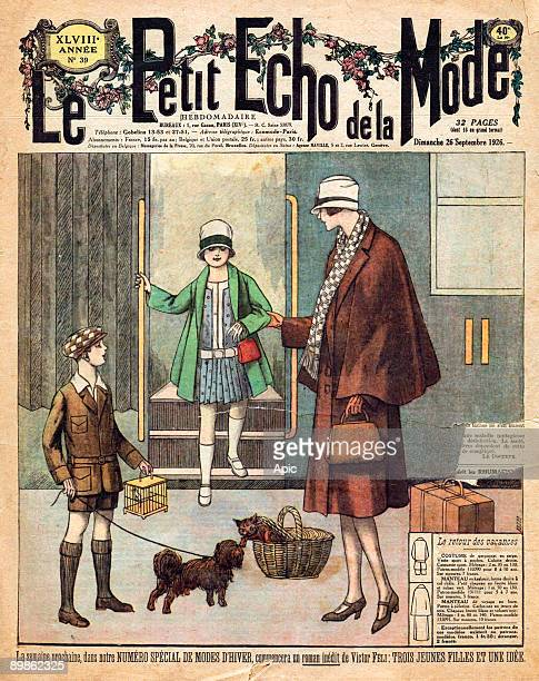 return from holidays woman and her children at the station front page of Petit Echo de la Mode september 26 1926