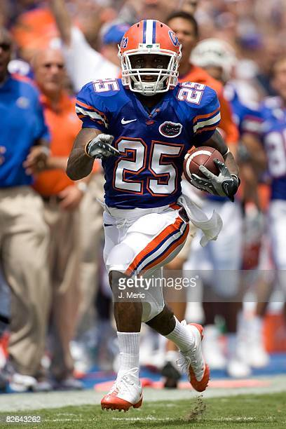 Return man Brandon James of the Florida Gators scores a touchdown on a punt return against the Hawaii Warriors during the game on August 30 2008 at...