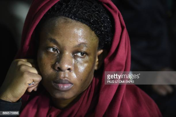 A returnee looks during screening by state officials after arriving in a chartered aircraft that brought home 150 migrants from Libya at the Murtala...