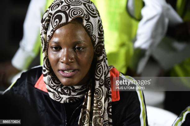 A returnee speaks to state officials during screening after leaving a chartered aircraft that brought home 150 migrants from Libya at the Murtala...