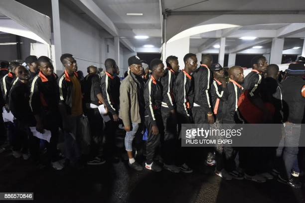 Returnees queue to be attended to by state officials after alighting from chartered aircraft that brought home 150 migrants from Libya at the Murtala...