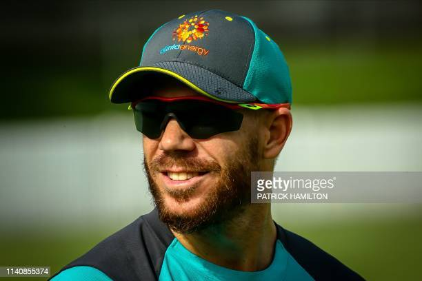 Returning Australian cricketer David Warner takes part in a cricket training session in the Albion suburb of Brisbane on May 3 2019 / IMAGE...