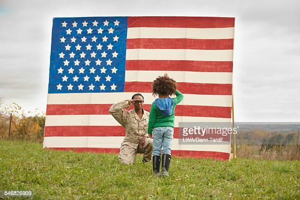 Returning Black soldier saluting daughter