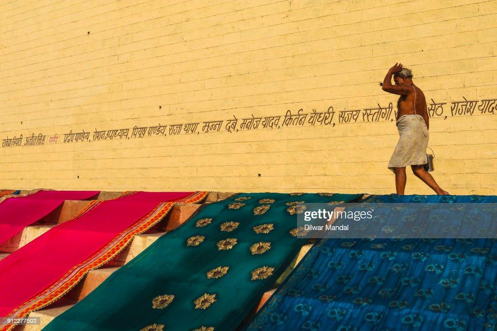 Returning from Bath in the Varanasi Ghat : Stock Photo