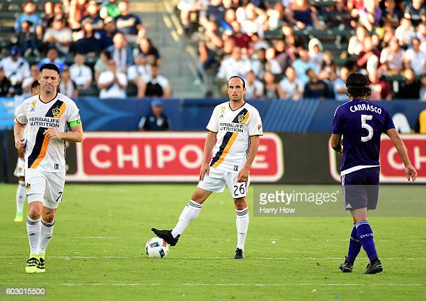 Returning from retirement Landon Donovan of the Los Angeles Galaxy waits for the clock to expire with Robbie Keane and Servando Carrasco of Orlando...