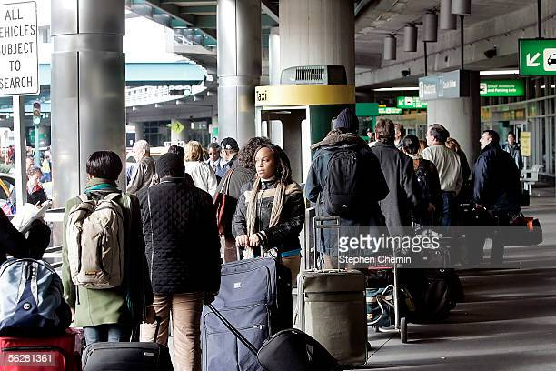 Returning holiday travelers queue up for cabs November 27, 2005 at LaGuardia Airport in New York City. According to a survey by the Auto Mobile Club...