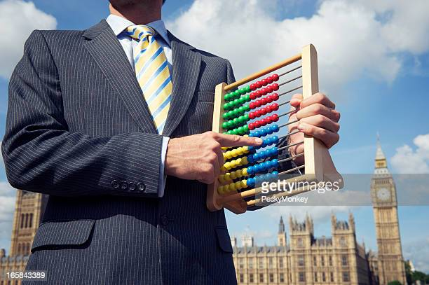 Returning Officer Holds Abacus at Houses of Parliament