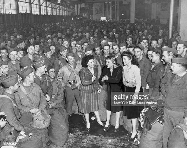 Returning soldiers are entertained by the Andrew Sisters Maxene LaVerne and Patty at Pier 90