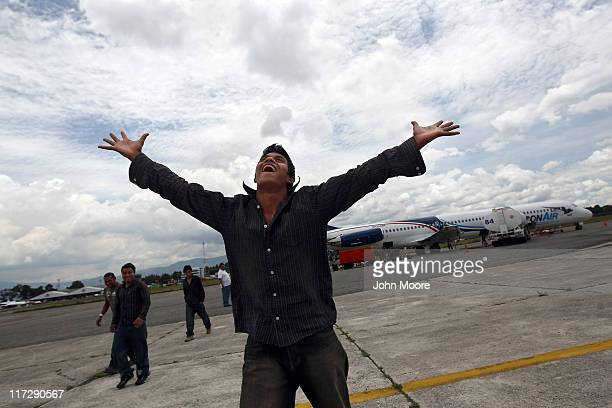 Returning undocumented Guatemalan immigrant Justo Velasquez gives thanks to God after arriving on a deportation flight from Mesa Arizona on June 24...