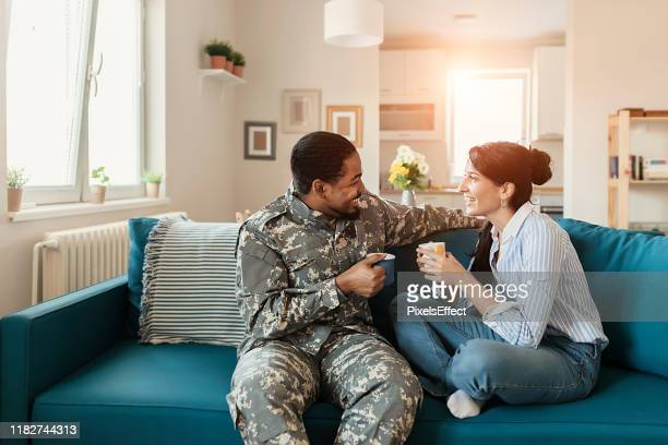 returns from the military - happy memorial day stock pictures, royalty-free photos & images