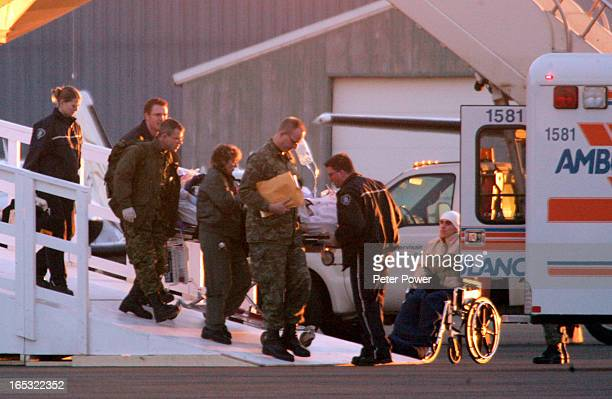 The first soldier Pte William Salikin is taken from the aeroplane to a waiting ambulance The three soldiers injured in Afghanistan on January 15 2006...