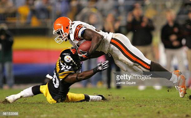 Reuben Droughns of the Cleveland Browns dives for extra yardage as Bryant McFadden of the Pittsburgh Steelers defends during the second half of the...