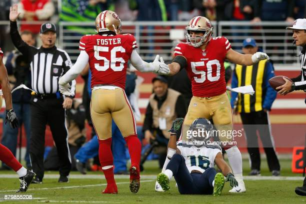 Reuben Foster and Brock Coyle of the San Francisco 49ers celebrate after tackling Tyler Lockett of the Seattle Seahawks at Levi's Stadium on November...