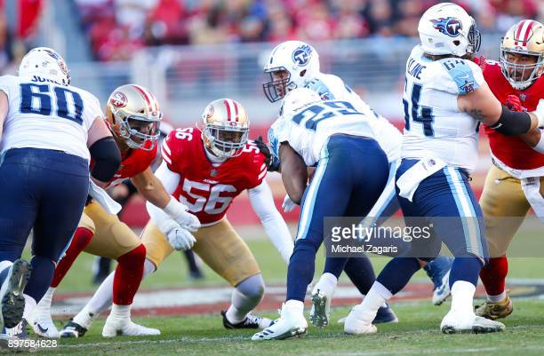 Reuben Foster and Brock Coyle of the San Francisco 49ers tackle DeMarco Murray of the Tennessee Titans during the game at Levi's Stadium on December...