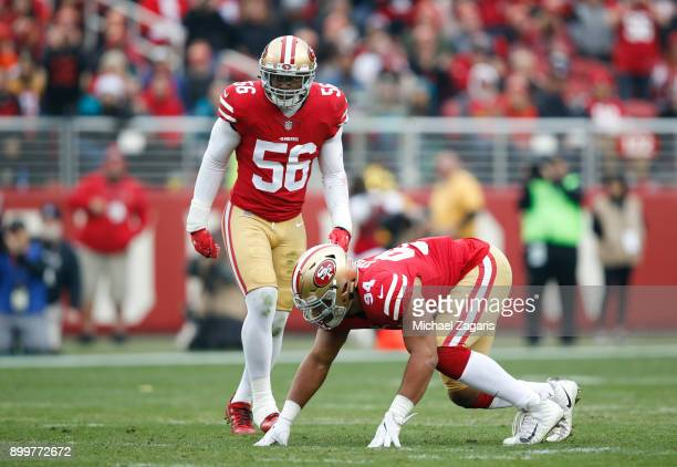 Reuben Foster and Solomon Thomas of the San Francisco 49ers defend during the game against the Jacksonville Jaguars at Levi's Stadium on December 24...