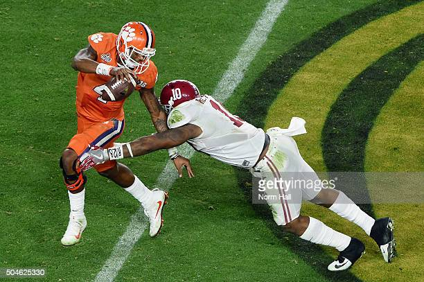 Reuben Foster of the Alabama Crimson Tide attempts to tackle Deshaun Watson of the Clemson Tigers during the 2016 College Football Playoff National...