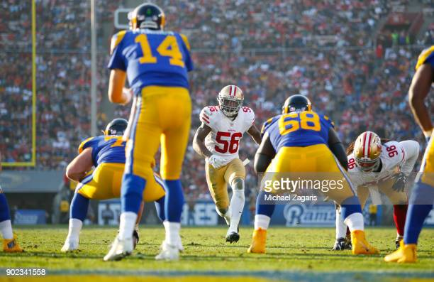 Reuben Foster of the San Francisco 49ers blitzes during the game against the Los Angeles Rams at Los Angeles Memorial Coliseum on December 31 2017 in...