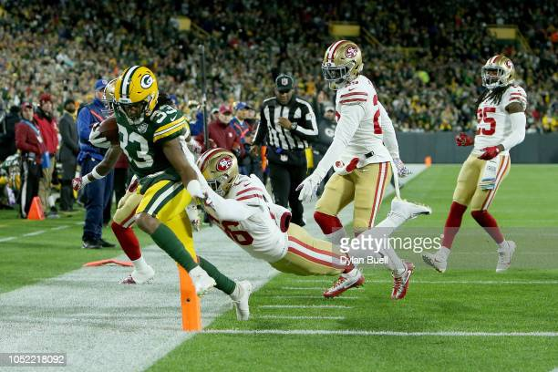 Reuben Foster of the San Francisco 49ers forces Aaron Jones of the Green Bay Packers out of bounds in the first quarter at Lambeau Field on October...
