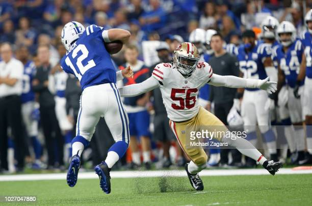 Reuben Foster of the San Francisco 49ers pressures Andrew Luck of the Indianapolis Colts during the game at Lucas Oil Stadium on August 25 2018 in...