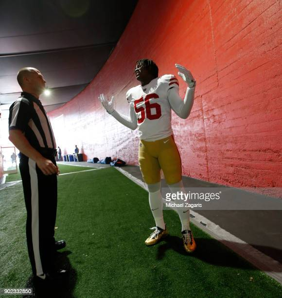 Reuben Foster of the San Francisco 49ers talks with an official in the tunnel prior to the game against the Los Angeles Rams at Los Angeles Memorial...