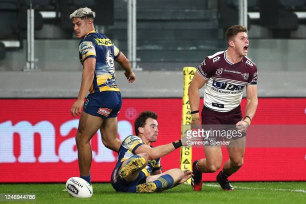 Reuben Garrick of the Sea Eagles celebrates scoring the match winning try that was then disallowed following a Sea Eagles forward pass during the...
