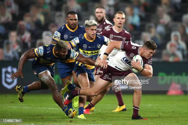 Reuben Garrick of the Sea Eagles is tackled during the round four NRL match between the Parramatta Eels and the Manly Sea Eagles at Bankwest Stadium...