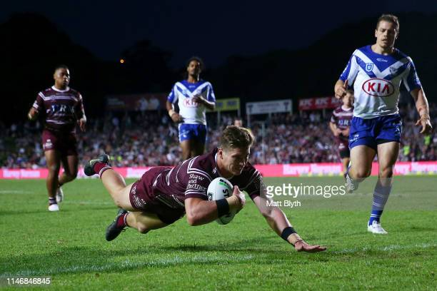 Reuben Garrick of the Sea Eagles scores a try during the round eight NRL match between the Manly Warringah Sea Eagles and the Canterbury Bulldogs at...
