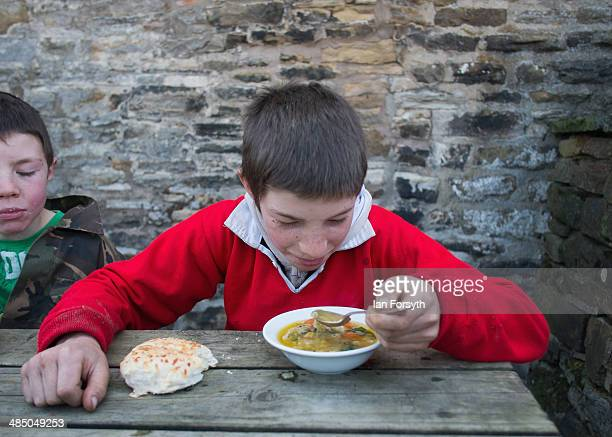 Reuben Owen has soup for lunch at Ravenseat the farm of the Yorkshire Shepherdess Amanda Owen on April 15 2014 near Kirkby Stephen England Amanda...