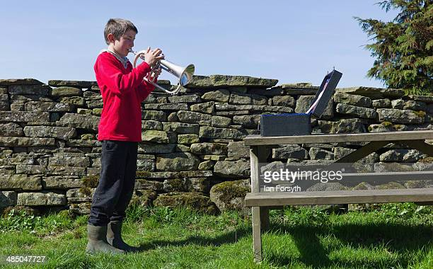 Reuben Owen takes time out from his chores to practice his Flugelhorn playing at Ravenseat the farm of the Yorkshire Shepherdess Amanda Owen on April...