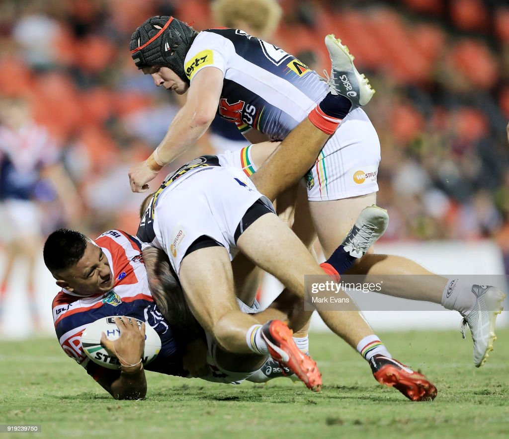 Reuben Porter of the Roosters is tackled during the NRL trial match between the Penrith Panthers and the Sydney Roosters at Penrith Stadium on February 17, 2018 in Sydney, Australia.