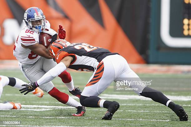 Reuben Randle of the New York Giants is brought down by Terence Newman of the Cincinnati Bengals during their game at Paul Brown Stadium on November...