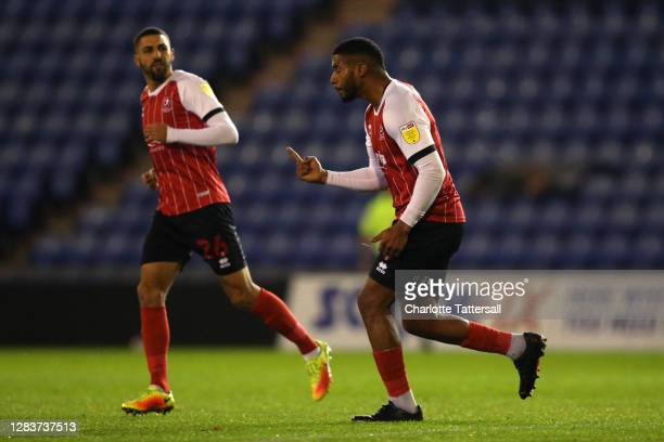 Reuben Reid of Cheltenham Town celebrates his goal with teammates during the Sky Bet League Two match between Oldham Athletic and Cheltenham Town at...
