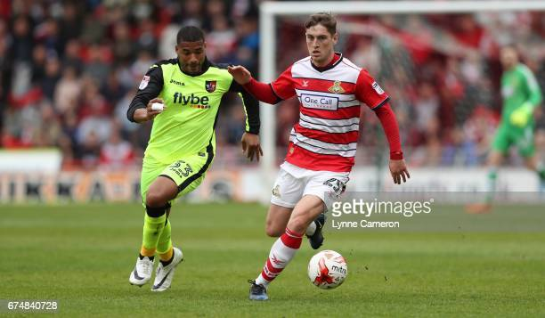 Reuben Reid of Exeter City and Conor Grant of Doncaster Rovers during the Sky Bet League Two match between Doncaster Rovers and Exeter City at...