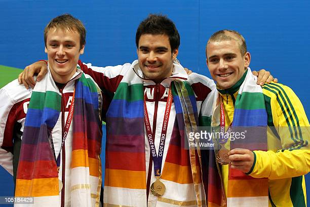 Reuben Ross of Canada, Alexandre Despatie of Canada and Grant Nel of Australia pose with the medals won in the Men's 3m Springboard Final at Dr. S.P....