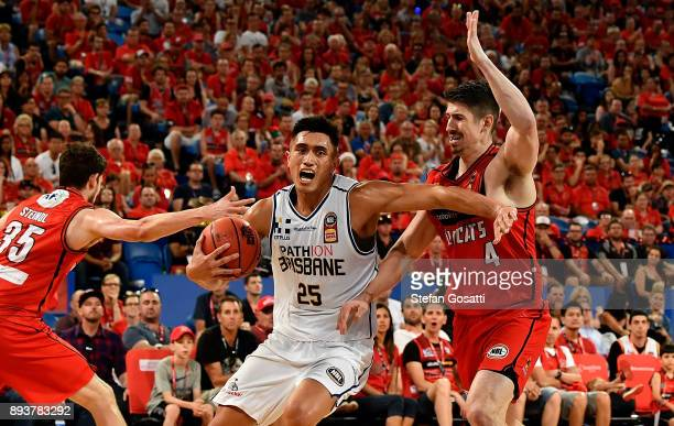 Reuben Te Rangi of the Bullets controls the ball against Clint Steindl and Greg Hire of the Wildcats during the round 10 NBL match between the Perth...