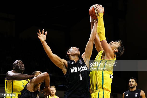 Reuben Te Rangi of the Tall Blacks and David Andersen of the Boomers compete for the ball during the game two match between the New Zealand Tall...