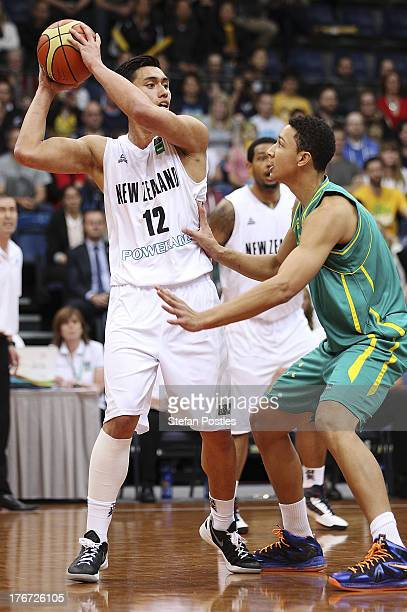 Reuben Te Rangi of the Tall Blacks looks to pass the ball during the Men's FIBA Oceania Championship match between the Australian Boomers and the New...