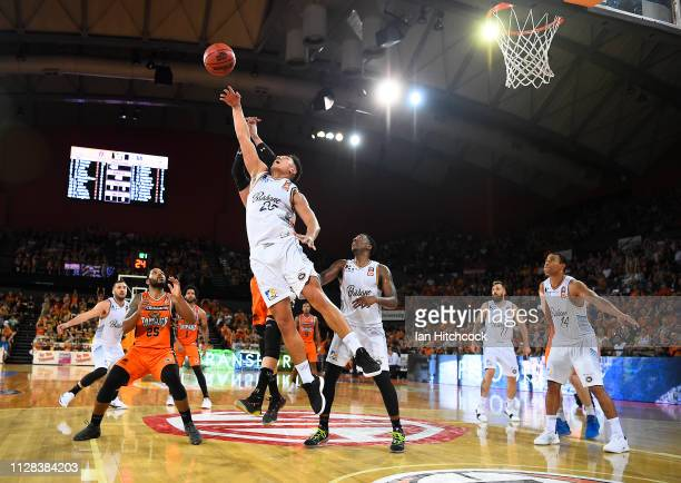 Reuben Terangi of the Bullets and Alex Loughton of the Taipans contests the ball during the round 17 NBL match between the Cairns Taipans and the...