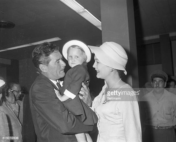 Reunion For Errol Flynn in Havana Havana Cuba Actor Errol Flynn hugs his little daughter Arnella 2 1/2 as his wife Patrice Wymore watches in a...