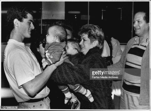 Reunion of the Fuchs family at Mascot Mark Fuchs 20 greets his baby brother Jason with he has never met before Jasons mother and father Carol and Eli...