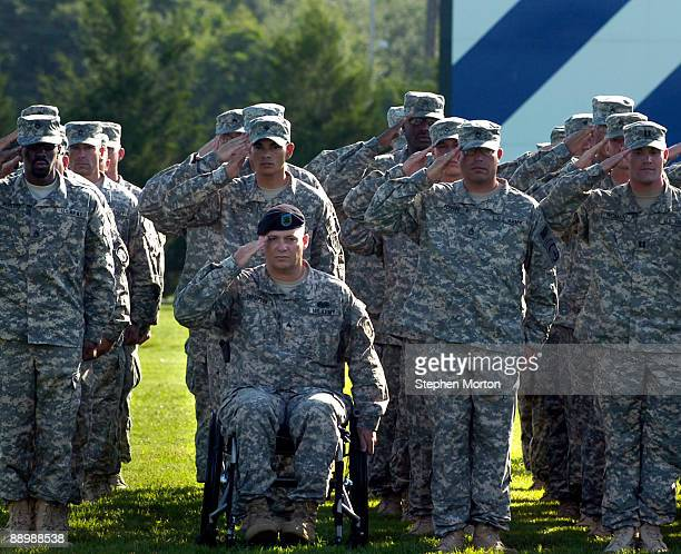 Reunited with his battalion, after being paralyzed by small arms fire in Afghanistan over a year ago, Sgt. Garry Kelly, along with 130 Soldiers with...