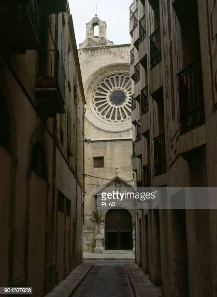 Reus province of Tarragona region El Baix Camp Catalonia Spain Abadia street in the old town At the bottom Church of St Peter built in 16th century...