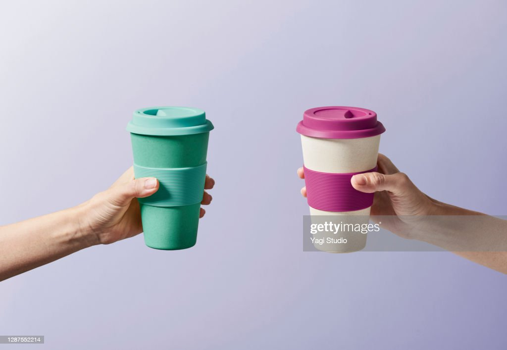 Reusable coffee cup in hand : Stock Photo