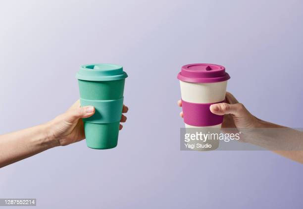 reusable coffee cup in hand - reusable stock pictures, royalty-free photos & images