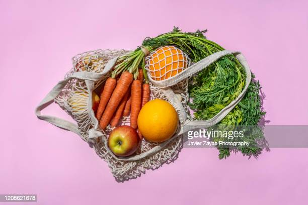 reusable cotton mesh bag with fruit and vegetables - vegetarian food stock pictures, royalty-free photos & images