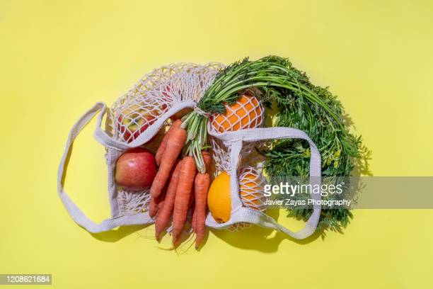 reusable cotton mesh bag with fruit and vegetables - freshness stock pictures, royalty-free photos & images