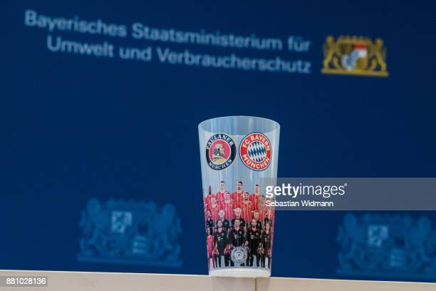 A reusable cup with the logo of FC Bayern Muenchen sits on a table before a press conference at the Bayerische Staatsministerium fuer Umwelt und...