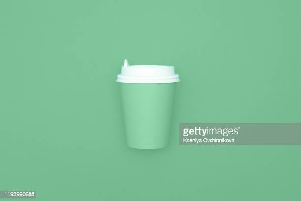 reusable eco friendly bamboo cup for take away coffee on mint background. space for text. flat lay, top view. bring your own cup concept. zero waste, sustainable lifestyle. mock up. - reusable stock pictures, royalty-free photos & images